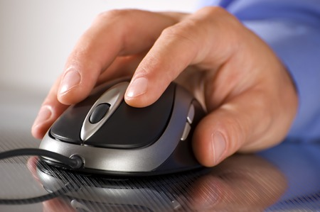 male business man hand on a computer mouse close up