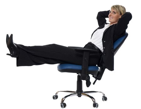 young blond business woman relaxing in a chair