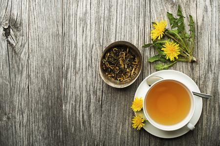 Foto de Cup of healthy dandelion tea on wooden background. Herbal medicine.  - Imagen libre de derechos