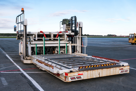 Photo for Aircraft container and pallet loader at the airport apron - Royalty Free Image