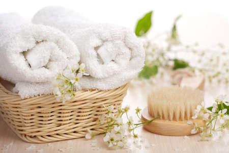 Foto de towels flowers and massage brush - Imagen libre de derechos