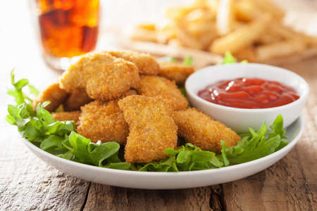 Photo for fast food chicken nuggets with ketchup, french fries, cola - Royalty Free Image