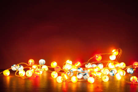 Photo for burning christmas lights decoration over red background - Royalty Free Image