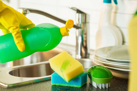 Foto de pouring dishwashing liquid on sponge kitchen wash cleaning - Imagen libre de derechos