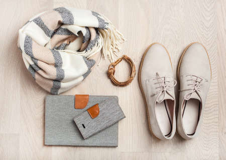 Photo for women's flat lay clothes shoes, scarf, bracelet, tablet, smartlphone. Fashion blog, clothing, shopping - Royalty Free Image