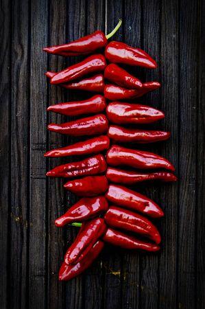 Photo pour Espelette peppers hanging at a door - image libre de droit