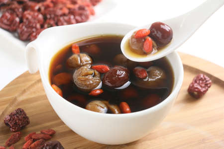 Photo for Wolfberry jujube tea longan in tea cup on wooden tray - Royalty Free Image