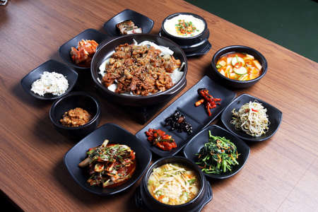 Photo pour A traditional korean tray meal on wooden table - image libre de droit