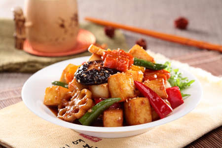 Photo for Lotus root simmered tofu with mushroom, chili and sliced lotus on white plate - Royalty Free Image