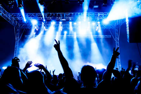 Photo for silhouettes of concert crowd in front of bright stage lights - Royalty Free Image