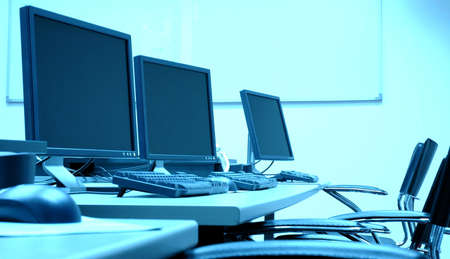 photo of blue screens in computer room, business concept