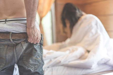 Foto de woman sit on a bed in a bedroom - concept photo of Sexual assault - Imagen libre de derechos