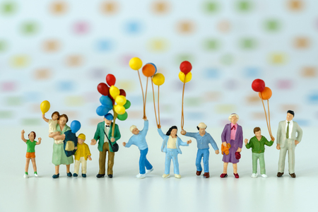Photo for Miniature people with family holding balloon with pop color dot background as happy family concept. - Royalty Free Image