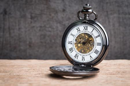 Foto de Vintage pocket mechanic watch on wooden table using as time symbol or business deadline concept. - Imagen libre de derechos