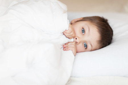 Photo for little boy in the bed sleeping daytime - Royalty Free Image