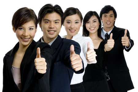 A young successful asian business team gives the thumbs up on white background