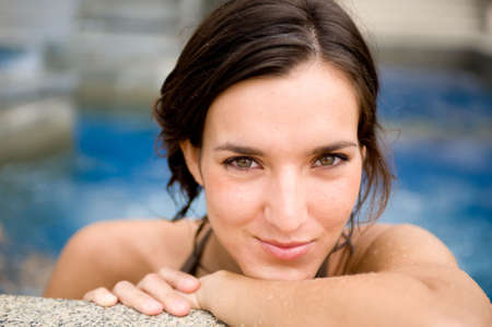 A young attractive woman in a swimming pool