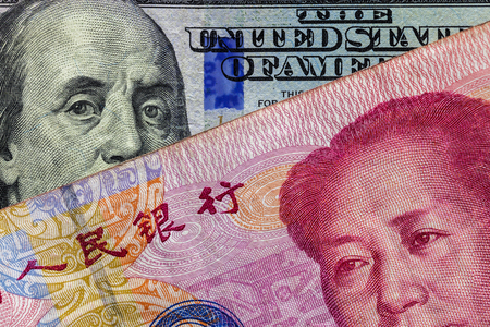 Foto de Close up of 100 Yuan banknote  over a one hundred Dollar banknote with focus on portraits of Benjamin Franklin and Mao Tse-tung/USA vs China trade war concept - Imagen libre de derechos
