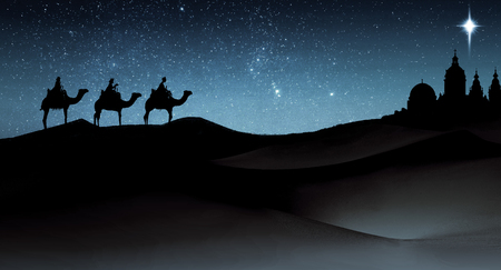 Foto de Three wise men Christmas card, with 3 kings on camels traveling on sand dunes, towards an ancient city with a single star above it, in evening light. - Imagen libre de derechos