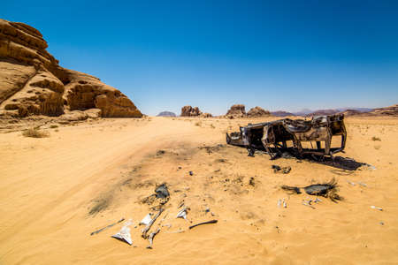 Burnt car in the middle of nowhere in Wadi Rum desert in Jordan. Looks like the car rolled or was flipped by the power of explosion that might have took place. Ashes and pices of tires were found all around the car.