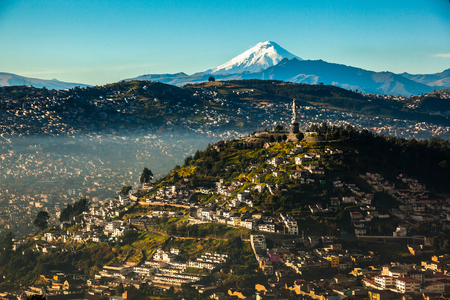 Photo for View of El Panecillo in the center of Quito with the Cotopaxi in the background - Royalty Free Image