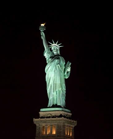 Foto de Statue of Liberty at night in New York Harbor USA. - Imagen libre de derechos