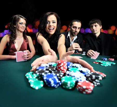 Foto de young beautiful woman playing in casino - Imagen libre de derechos
