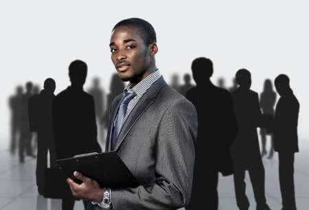 Photo pour Afro-American businessman with his team - image libre de droit