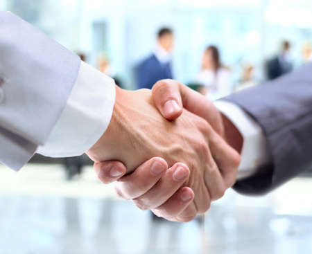 Photo pour Business handshake and business people - image libre de droit
