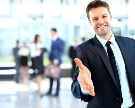 Photo for Portrait of a successful businessman giving a hand - Royalty Free Image