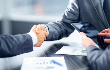 Photo for Business people shaking hands in office - Royalty Free Image
