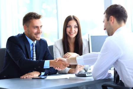 Foto de  businessman shaking hands to seal a deal with his partner - Imagen libre de derechos