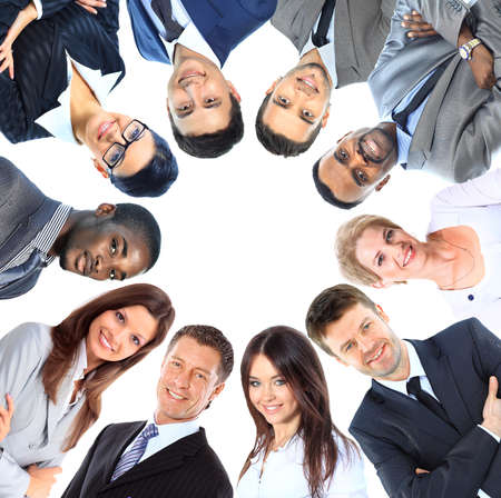 Photo for Group of business people standing in huddle, smiling, low angle view - Royalty Free Image
