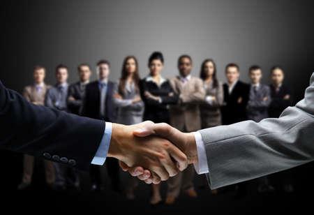 Foto de handshake isolated on business background  - Imagen libre de derechos