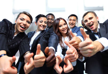 Photo pour Successful business people with thumbs up and smiling - image libre de droit