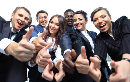 Photo for Happy multi-ethnic business team with thumbs up in the office - Royalty Free Image