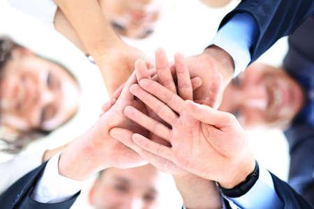 Foto de Small group of business people joining hands, low angle view - Imagen libre de derechos