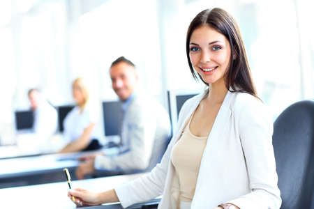 Photo for Business woman with her team at the office - Royalty Free Image