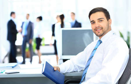 Photo for Portrait of smiling businessman working in office, looking camera - Royalty Free Image