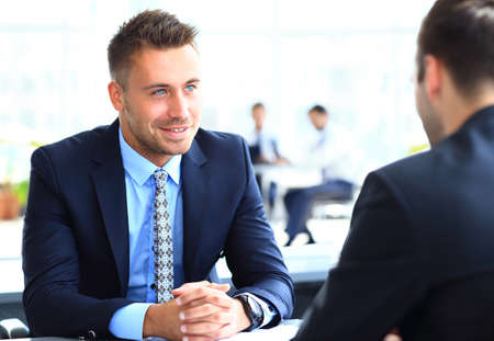 Photo pour Image of smart businessman explaining new strategy to his partner at meeting - image libre de droit