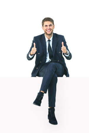 Photo for handsome young business man sitting on a white top - Royalty Free Image