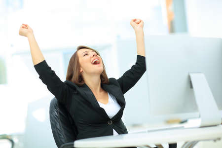 Photo pour Portrait of happy young successful businesswoman celebrate something with arms up - image libre de droit