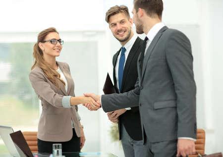 Photo pour Business partners shaking hands in the modern office - image libre de droit