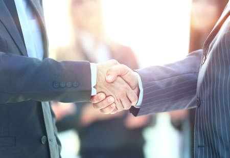Photo pour Business handshake. Business man giving a handshake to close the deal - image libre de droit