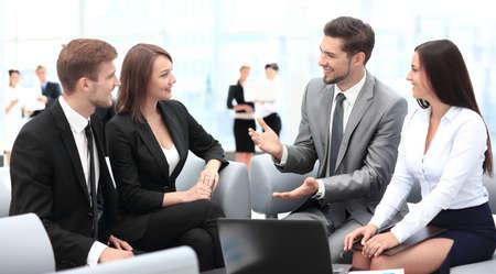Photo pour Happy business people talking on meeting at office - image libre de droit