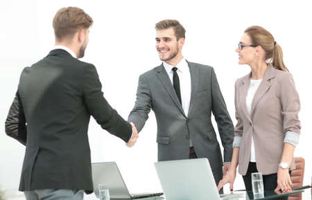 Photo for Happy smiling business people shaking hands after a deal in offi - Royalty Free Image