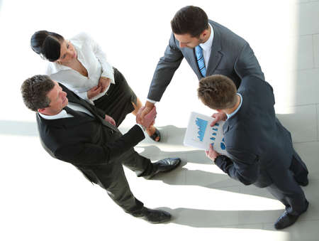 Photo for Business people closing a deal and handshaking at the office - Royalty Free Image