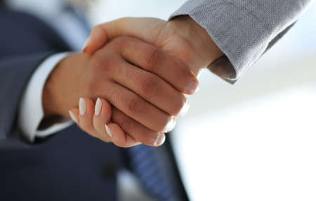 Photo for Business people shaking hands isolated on white background - Royalty Free Image