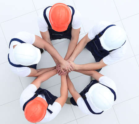 Photo for group of construction workers with hands clasped together - Royalty Free Image
