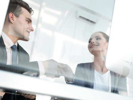 Photo for from behind the glass. handshake business partners - Royalty Free Image